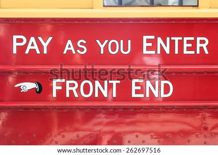 Text on an old touristic tram in Christchurch, New Zealand: pay as you enter - front end - stock photo
