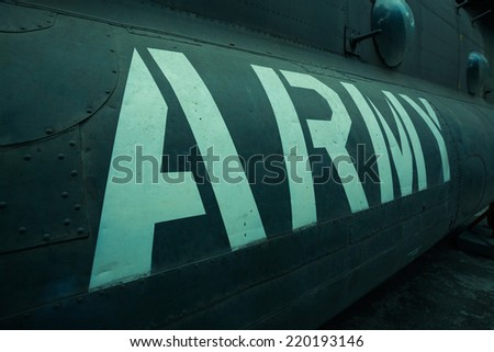 Text on an old war Airplane - stock photo