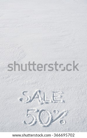 Text SALE 50 % hand written on snow background. Vertical postcard template. Space for copy, lettering. - stock photo