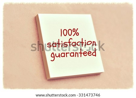 Text 100% satisfaction guaranteed on the short note texture background - stock photo