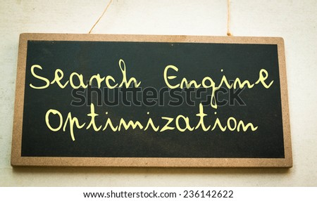 Text search engine optimization on board  - stock photo