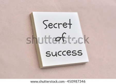 Text secret of success on the short note texture background - stock photo