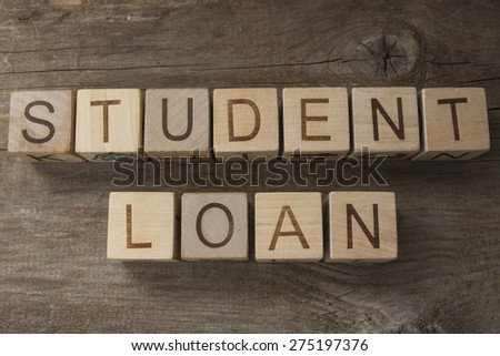 Text STUDENT LOAN on a wooden background - stock photo