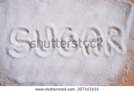 text sugar on sugar  background - stock photo
