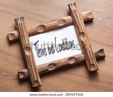 Text Term And Conditions written on wood frame - stock photo