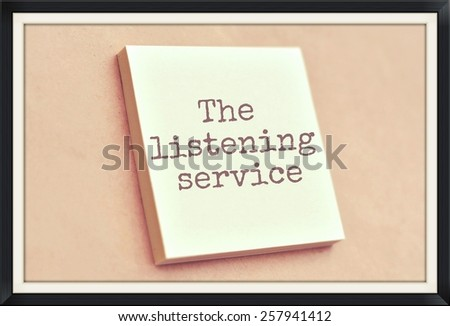 Text the listening service on the short note texture background - stock photo