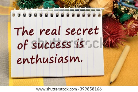 Text The real secret of success is enthusiasm on notebook