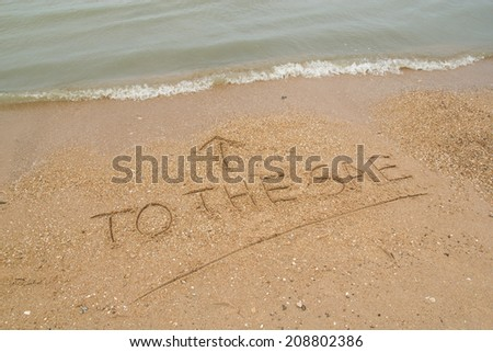 Text To hte sea on the sandy beach.