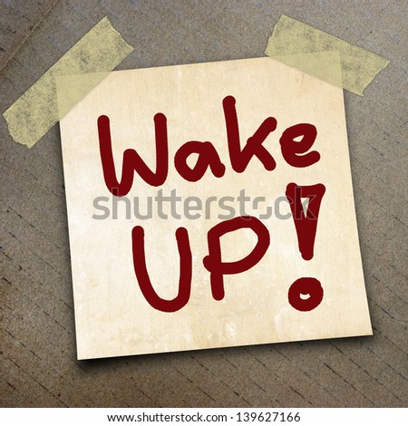 text wake  up  write on  paper on the packing paper box texture background - stock photo