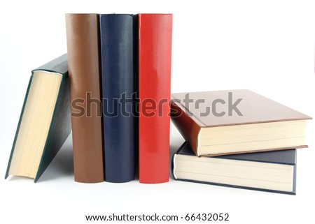 textbooks on white table - stock photo