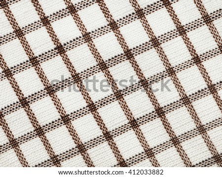 textile background - checkered cotton fabric with Calico weave pattern of threads close up - stock photo