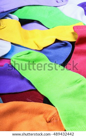 Textile colorful socks background. Green, pink, red, orange, yellow and other colors