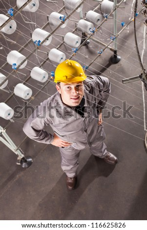 textile factory worker looking up - stock photo