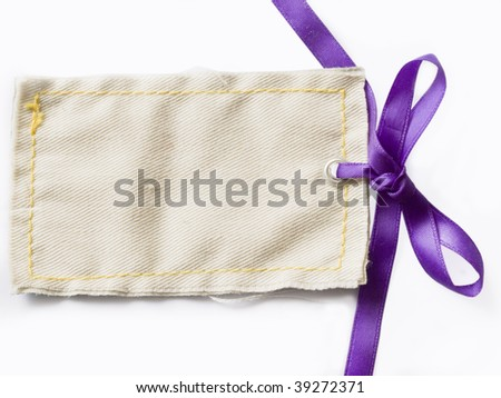 textile gift tag with saten bow - stock photo