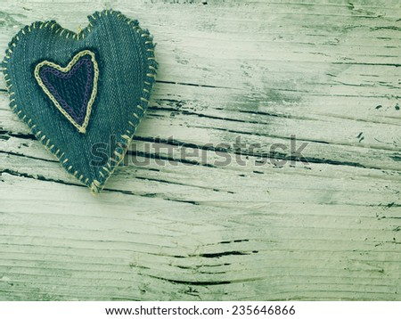 textile hearts on the wooden background - stock photo