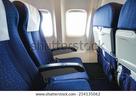 textile seats in economy class section of modern airplane - stock photo
