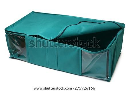 Textile storage box on white background - stock photo