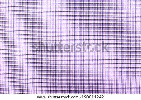 Textile texture in  blue cell. Whole background.