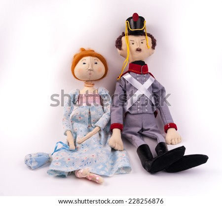 Textile toys. Couple of dolls in historic costumes of Napoleon era. Soldier and woman in gown. - stock photo