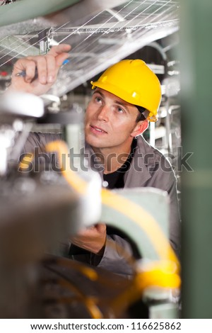textile worker conducting industrial quality control - stock photo
