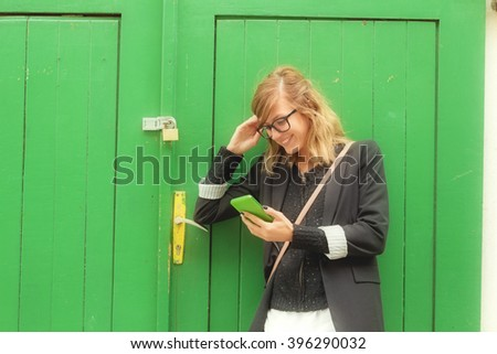 Texting on a smartphone outdoors. - stock photo