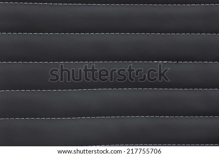 Texture background of leather sew by yarn