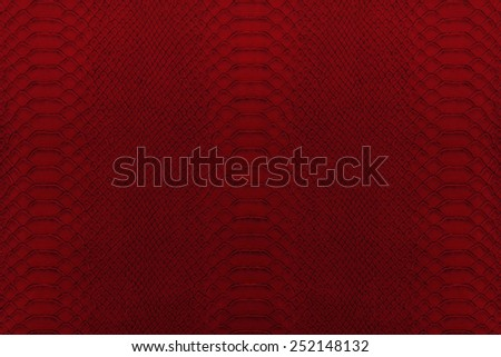 Texture background of red reptile leather