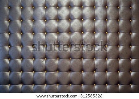 Texture brown leather upholstery with buttons - stock photo
