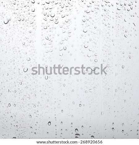 Texture drops of water on the transparent glass - stock photo