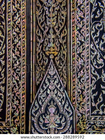 Texture from door in Thai temple. - stock photo