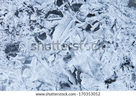Texture ice surface of a mountain river close up - stock photo