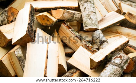 Texture made from wooden cut firewood, background - stock photo