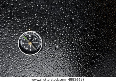 Texture metallic with drops water and compass