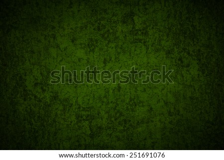 texture of a dilapidated wall in a green tone - stock photo