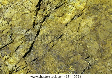 texture of a green rock, mineral background of a nature macro image - stock photo