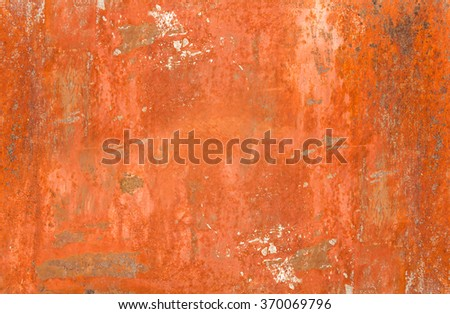 texture of a panel painted red ruined by weather - stock photo