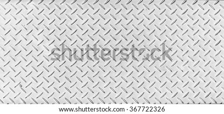 Texture of a tough metal diamond pattern plate. - stock photo