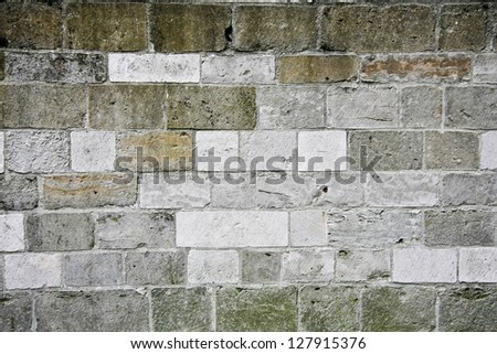 Texture of a wall with gray stones - stock photo