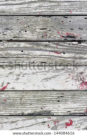 Texture of an old paint with cracks on a wall - stock photo
