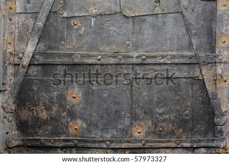 Texture of an old rusty and weathered iron door. - stock photo