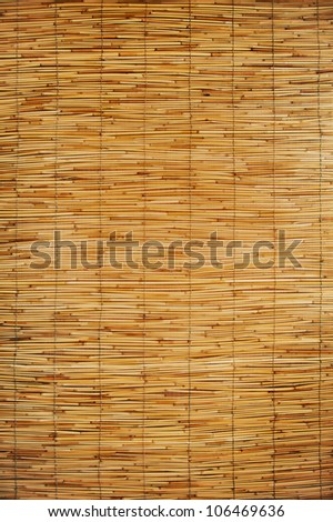 texture of an orange mats made ??of bamboo and rope - stock photo