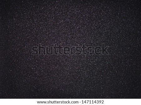 Texture of black foam with glitter - stock photo
