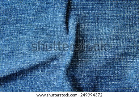 Texture of blue jeans background - stock photo