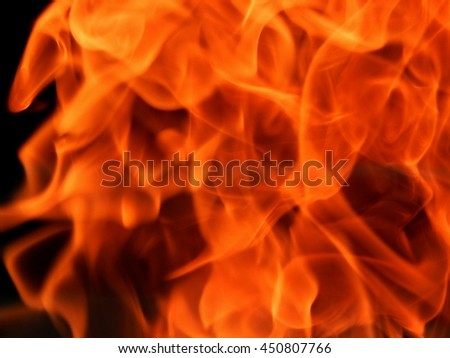 Texture of bright fire flames on a black background