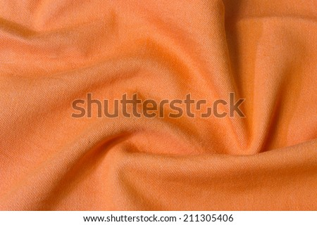 texture of bright orange fabric with folds - stock photo