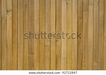 Texture of brown vertical stripes arranged in bamboo veneer in the background - stock photo