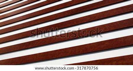 Texture of brown wooden lining boards on modern fence - stock photo