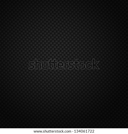 Texture of carbon fiber material. Dark background - stock photo