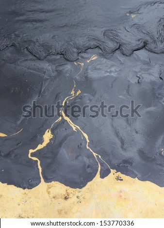 Texture of Crude oil spill on sand beach from oil spill accident on Ao Prao Beach at Samet island in Rayong province,Thailand. - stock photo