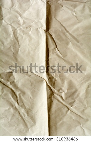 Texture of crumpled paper. Yellow brown paper sheet. Crumple and wrinkle background. - stock photo